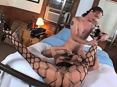 Busty milf in fishnet stockings exchanges oral pleasures with her man