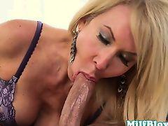 Busty mature slut sucks on young cock