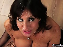 Horny babe gets cumshot on her face sucking all the semen