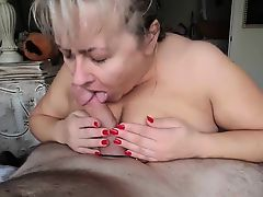 Mother with enormous set of breasts sucking dick