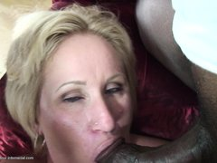 Molly loves to fill her mouth with cocks, especially big black hard ones! Here she is down on her kn