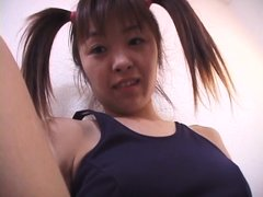 Clad in a sexy bathing suit, this Japanese slut plays with her favorite vibrator. She uses the hitac