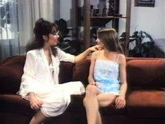 Retro lesbian brunette lady seduces a young blonde girl