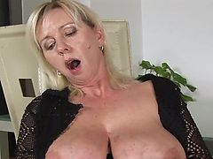 Mature with big tits and shaved pussy