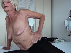 With short hair, fragile body and small tits this mature blonde still keeps some time for masturbati
