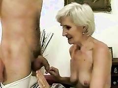 Hot granny enjoys sex with a boy
