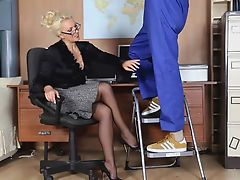 Horny blonde secretary sucks off workmans big spunking cock